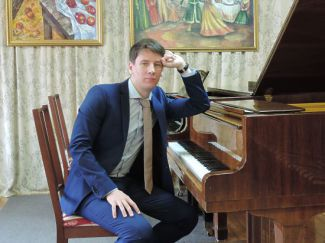 Роман Меренков