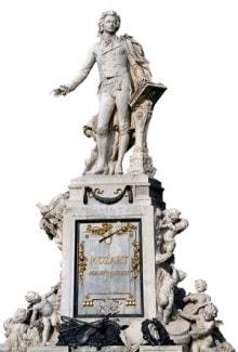 Памятник Моцарту в бывшем Императорском саду Бурггартене, Вена. Создан в 1896 году по эскизу Виктора Тильгнера. На пьедестале изображены сцены из опер композитора, а у подножия — клумба в форме скрипичного ключа