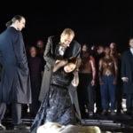 Отелло (Марко Берти) унижает Дездемону (Светлана Аксенова) к большому удовольствию Яго (Клаудио Сгура). Фото - Hans JOrg Michel